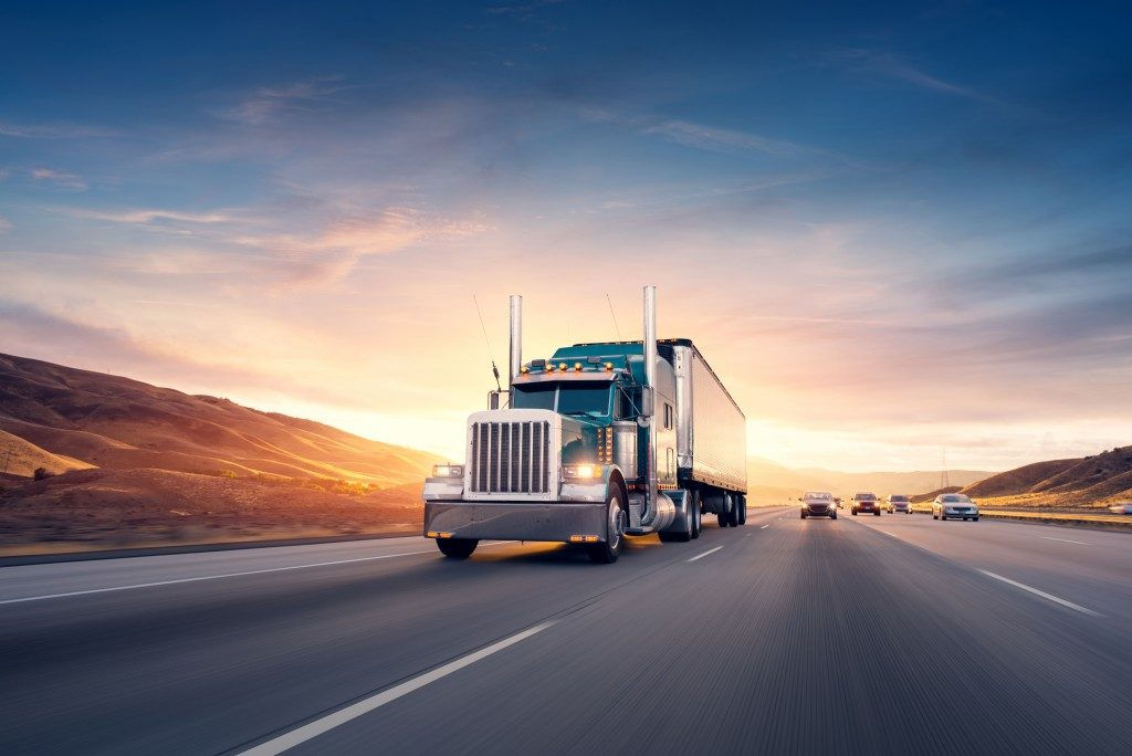 Freight truck with sunset background