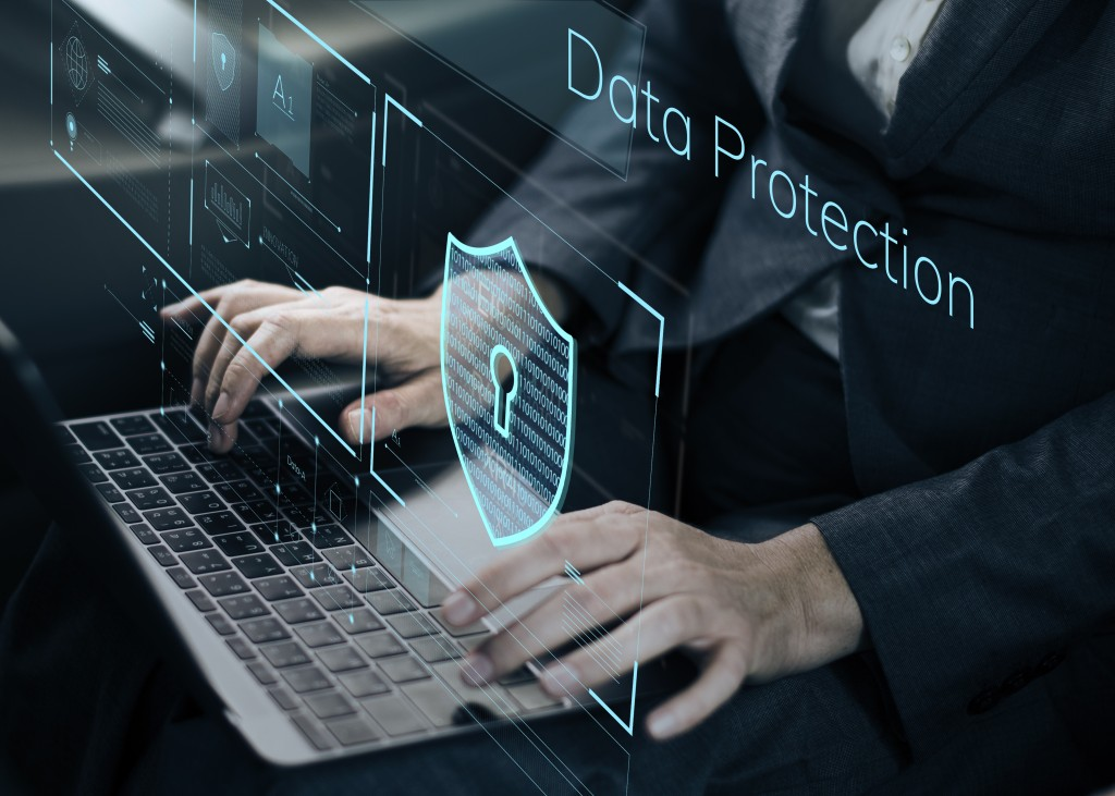 data protection digital image above a person using a laptop