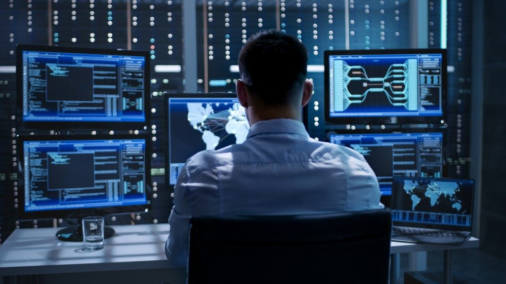 IT expert managing cybersecurity